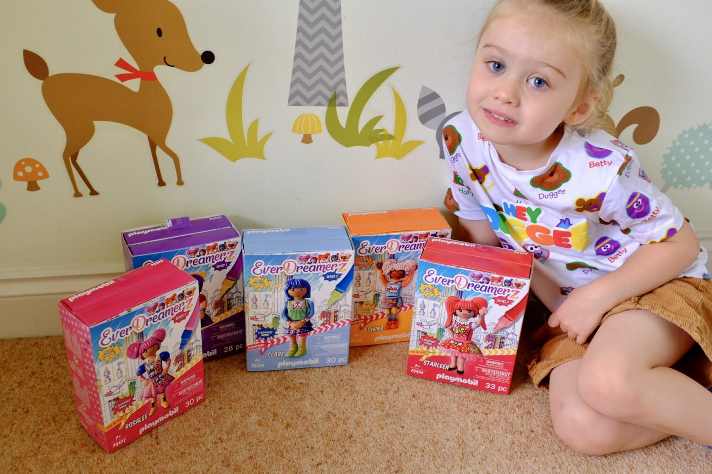 girl say with boxes of Playmobil Everdreamerz series 2
