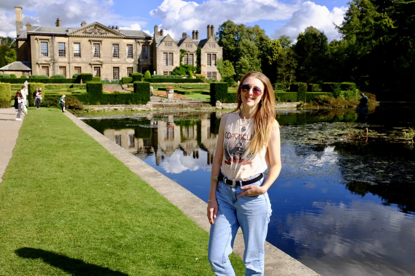 girl in front of the water at coombe abbey park