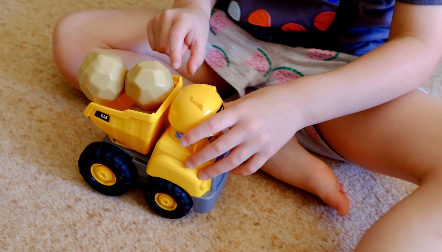 girl playing with the construction pal assortment toy