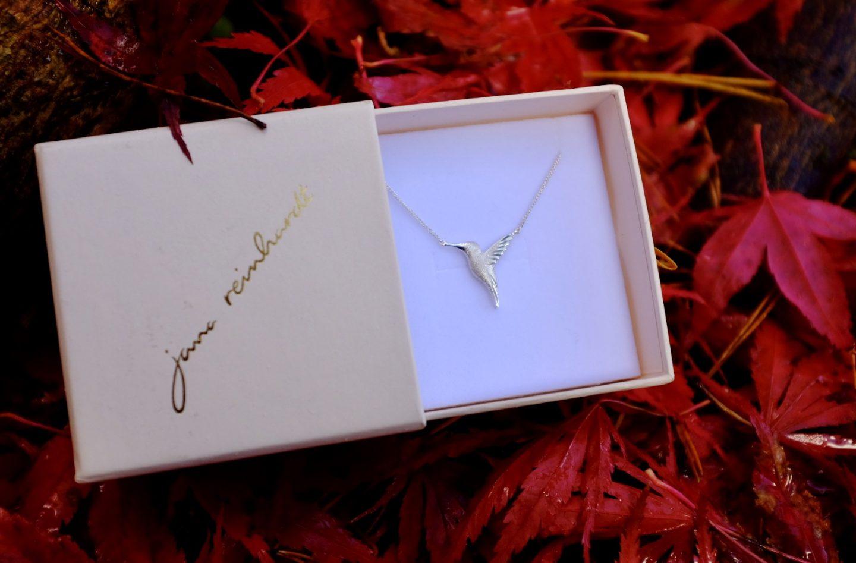 Jana Reinhardt. hummingbird necklace in a box