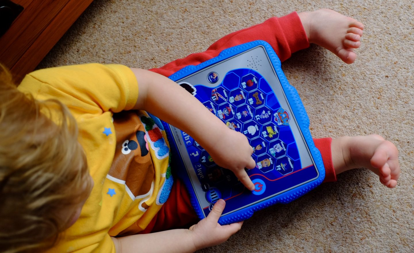 baby boy playing with Ryder's alphabet tablet