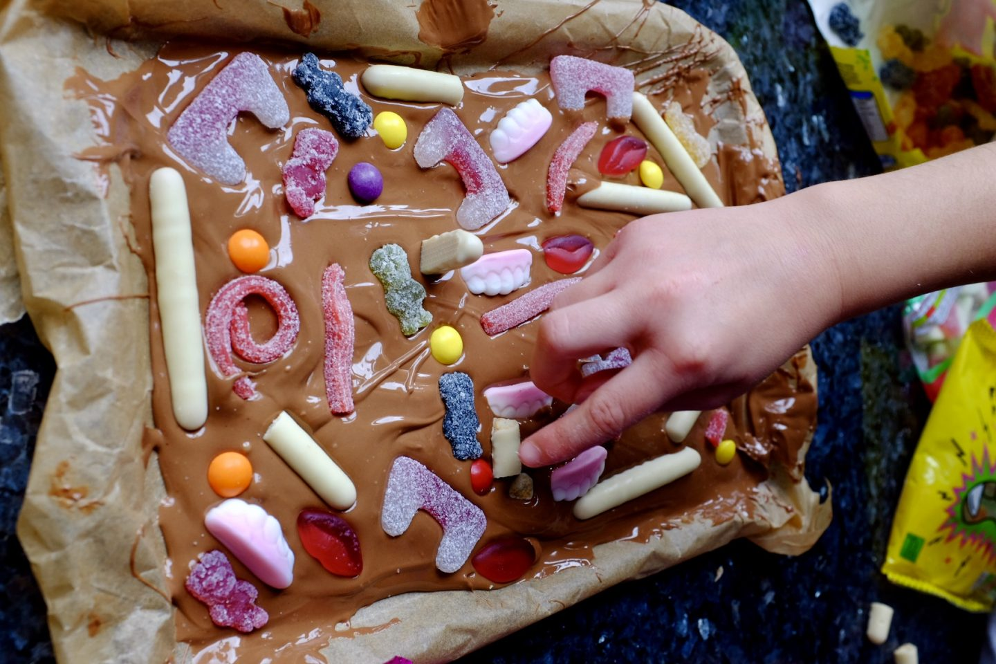 decorating Halloween bark with sweets