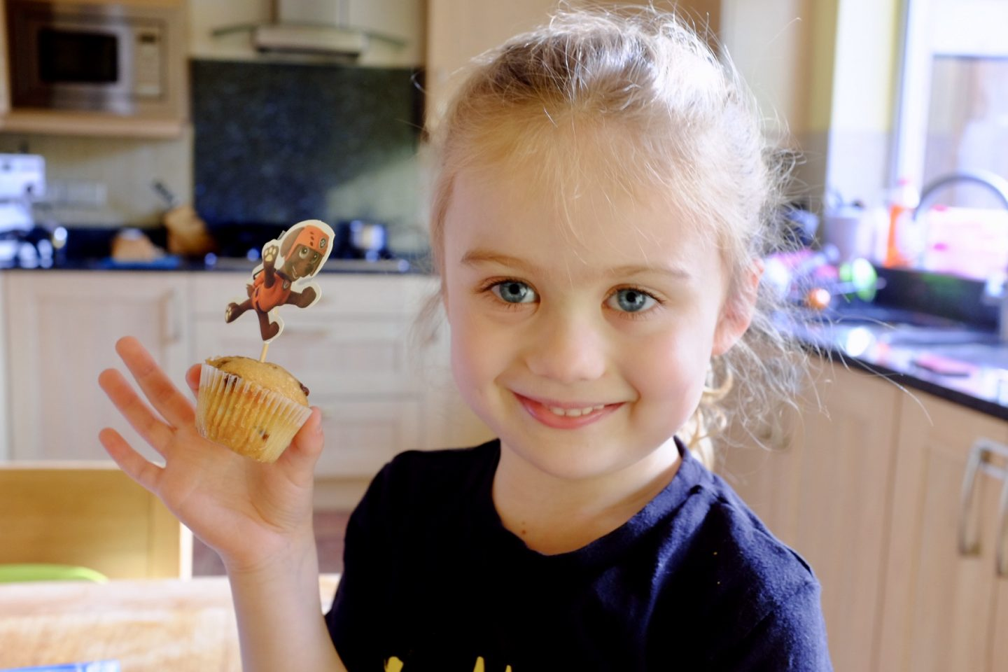 girl with cake decorated with Paw patro
