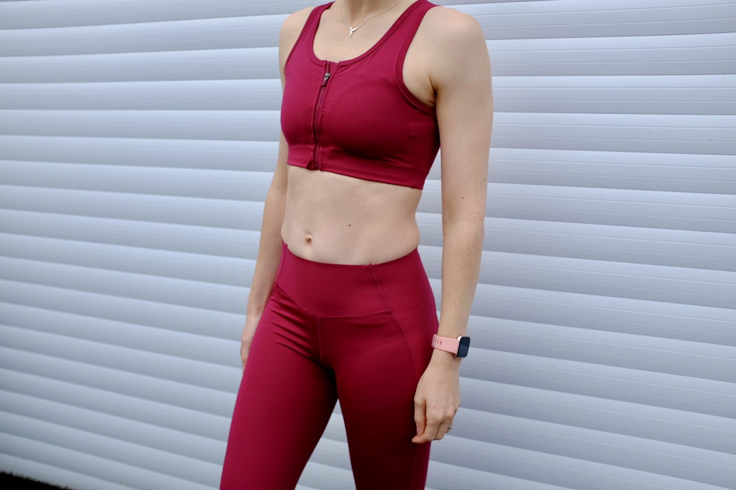 girl wearing the velocity leggings and bra top in plum
