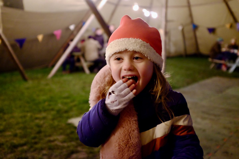 girl eating at the Malvern Winter glow
