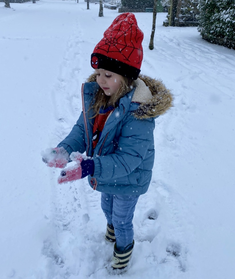 girl playing in the snow - coping with lockdown