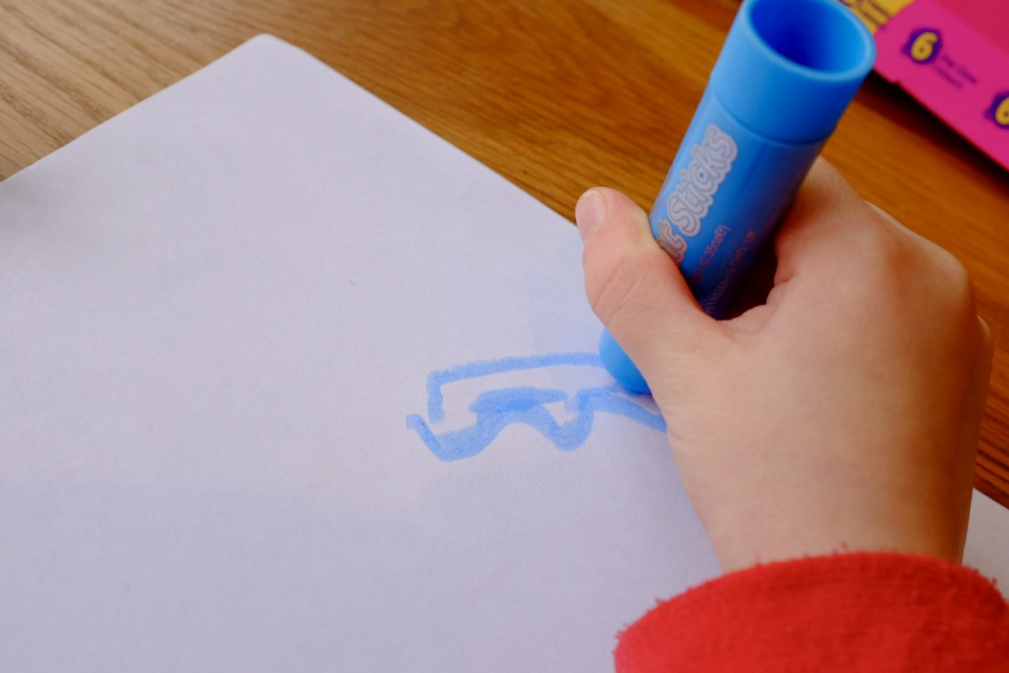 girl drawing with a paint stick