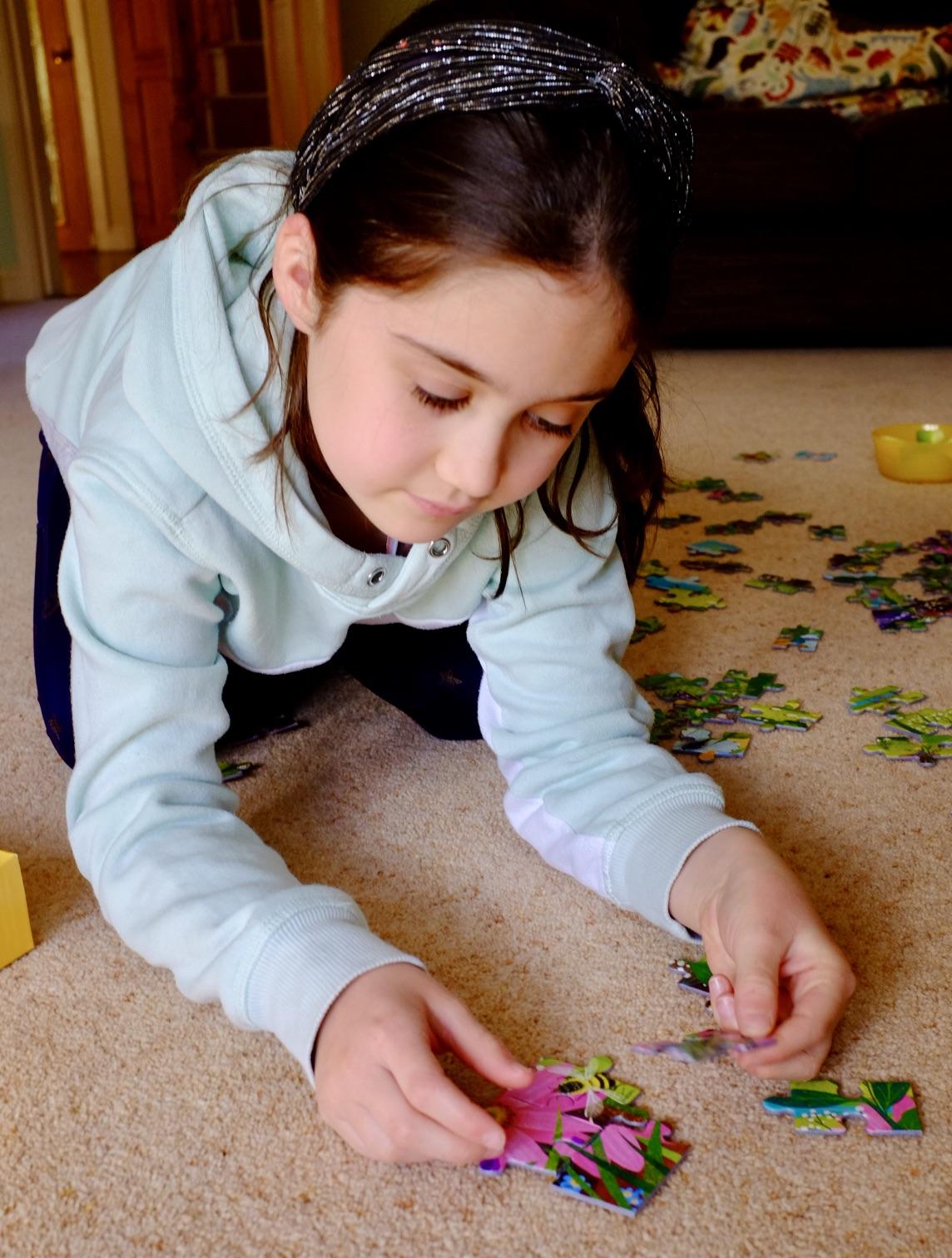 girl doing a jigsaw