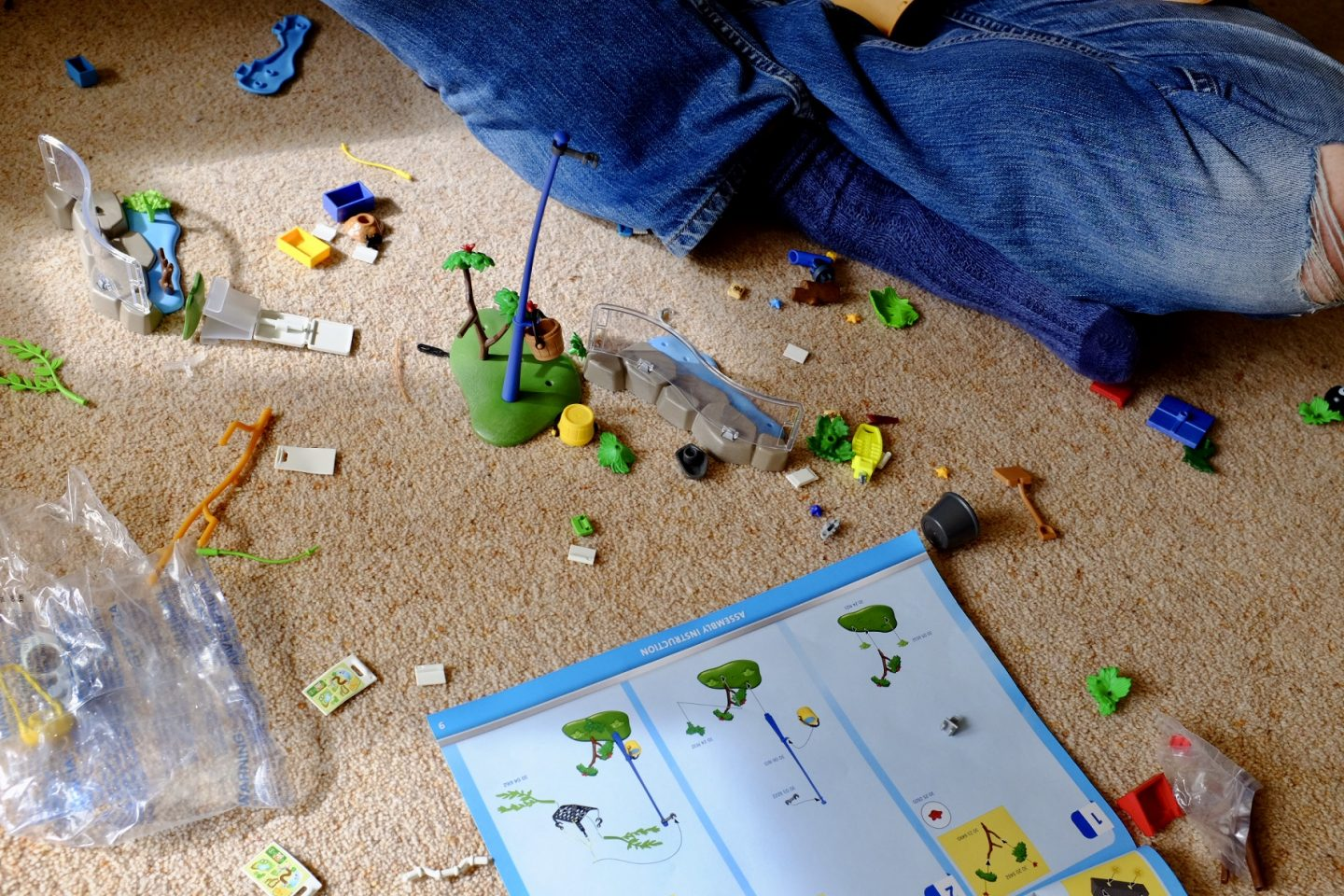 parts from Playmobil Family Fun Large City Zoo all over the floor