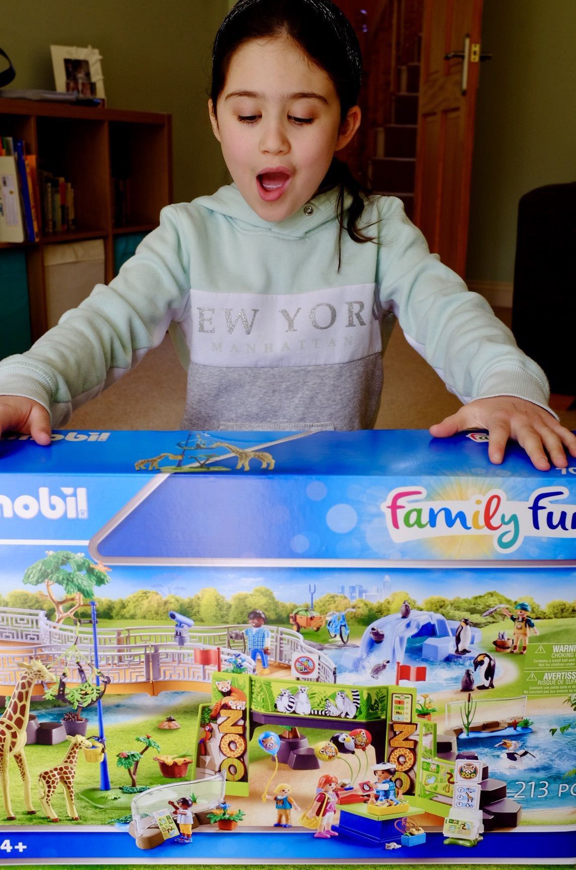 girl with Playmobil Family Fun Large City Zoo in box