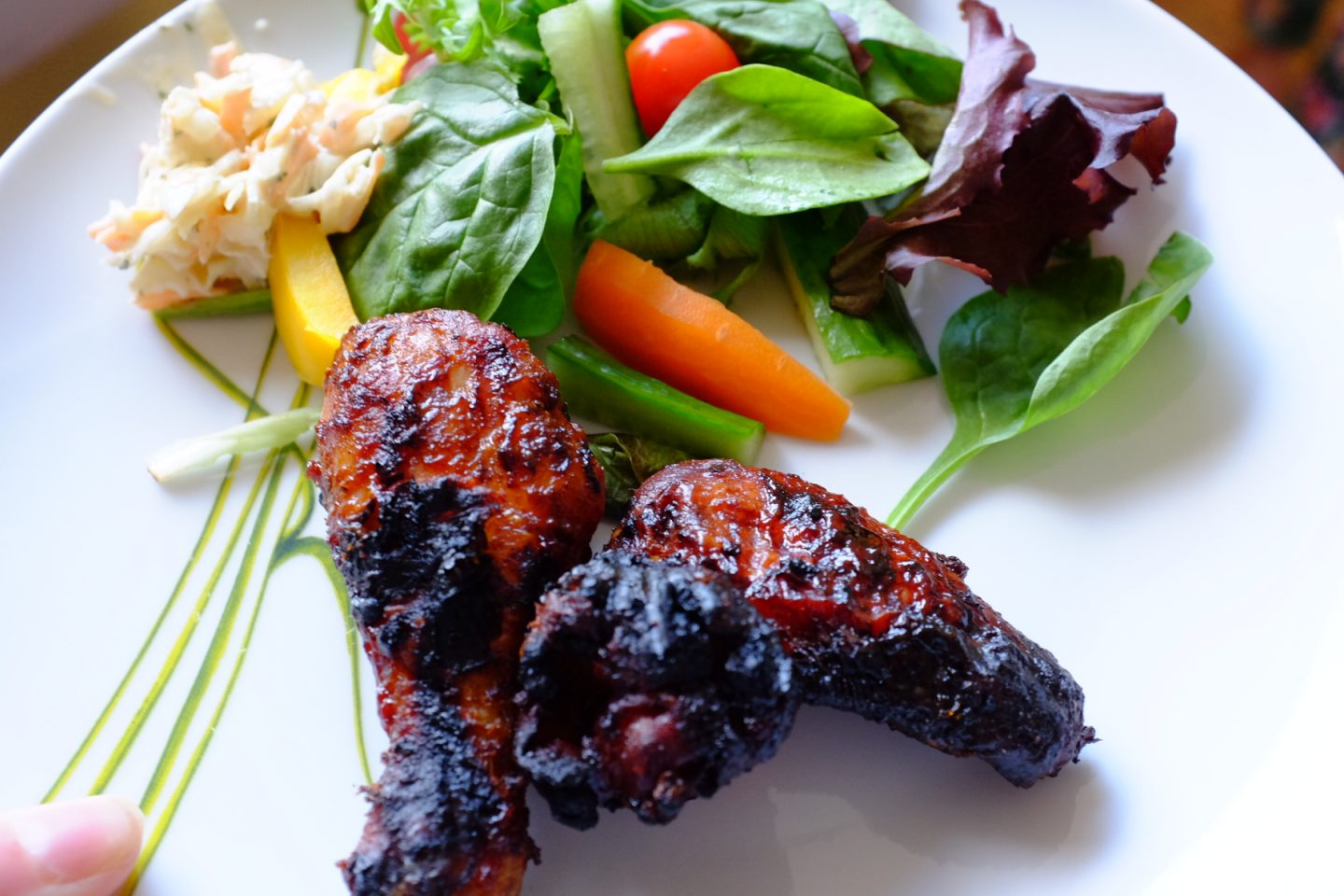 BBQ chicken and salad on a plate from Jacks supermarket