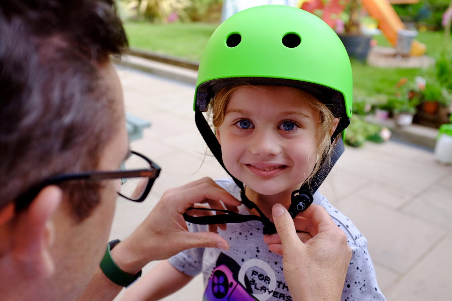 girl with a green SFR Scooter helmet