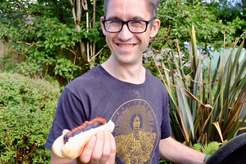 man holding a hotdog