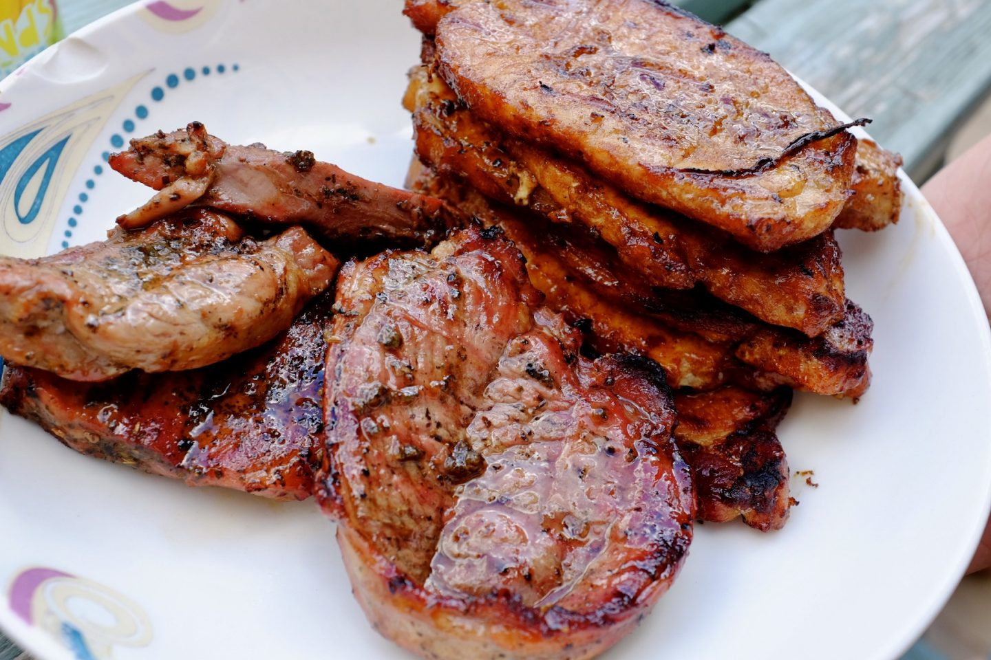 pork and lamb steaks cooked on a BBQ