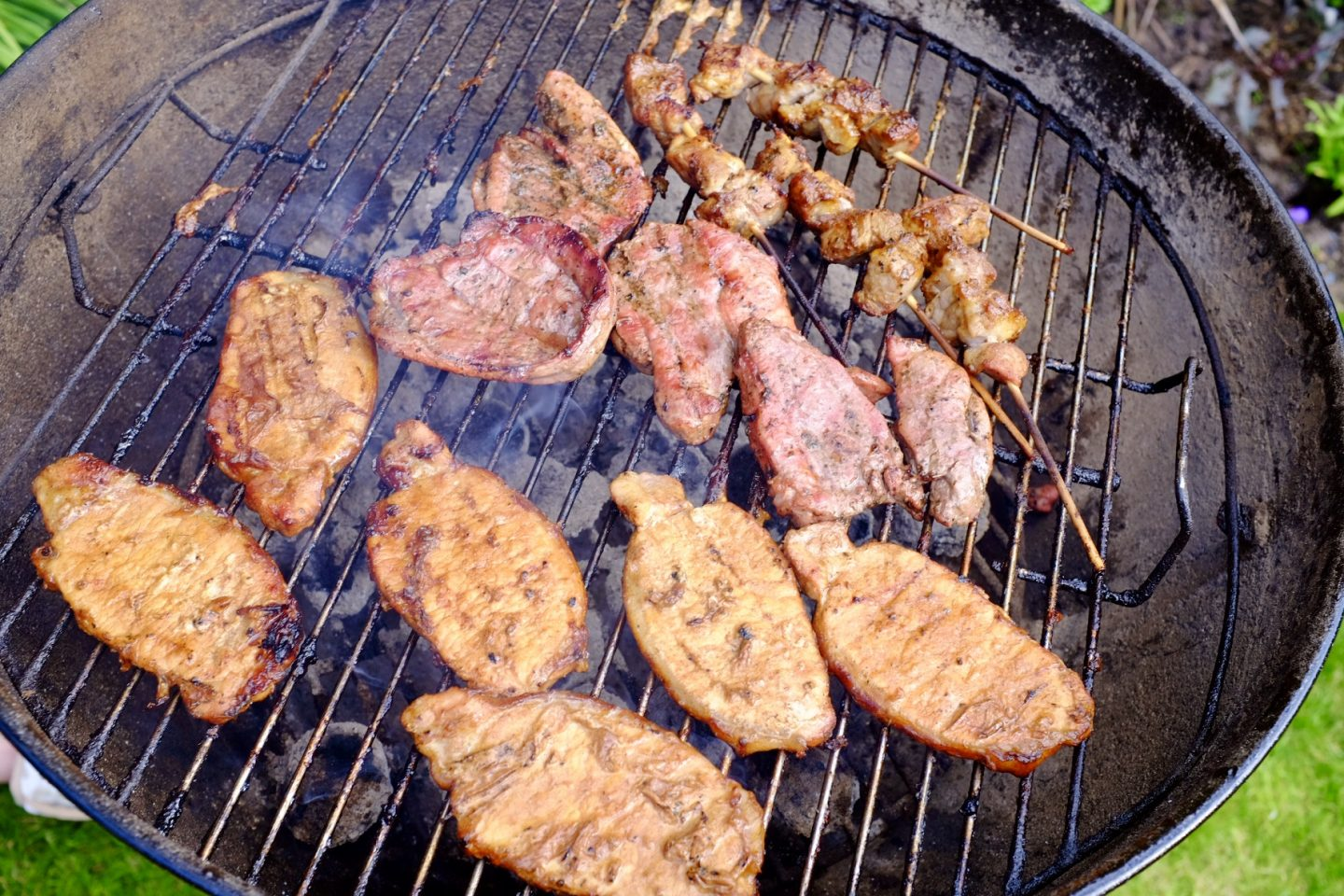 meat from Jacks cooking on a charcoal BBQ