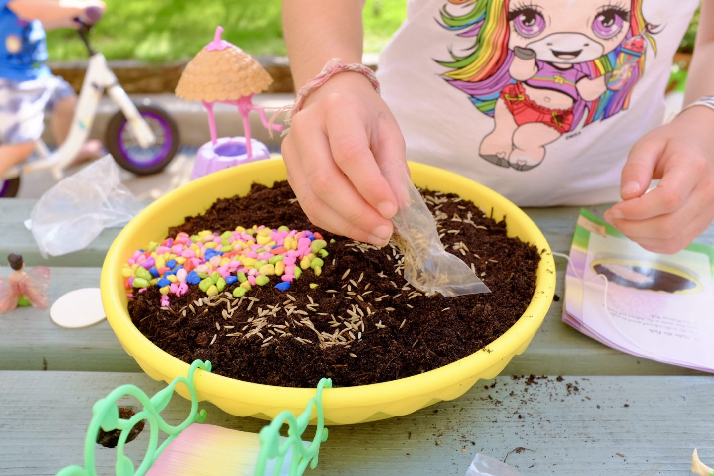 sprinkling seeds on my fairy garden compost