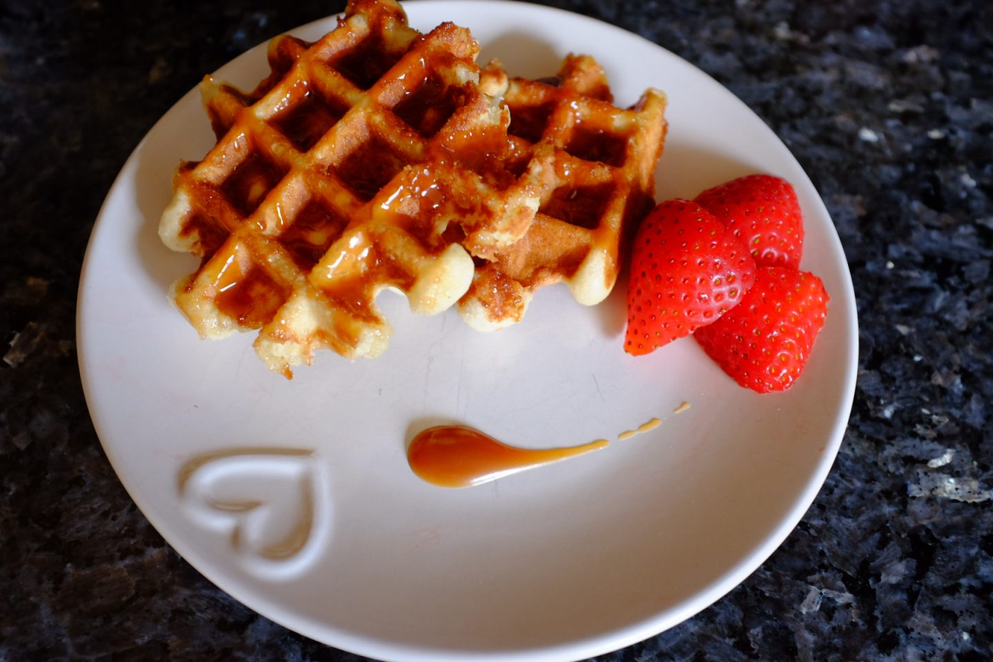 Belgian waffles with bad brownie salted caramel sauce and stawberries