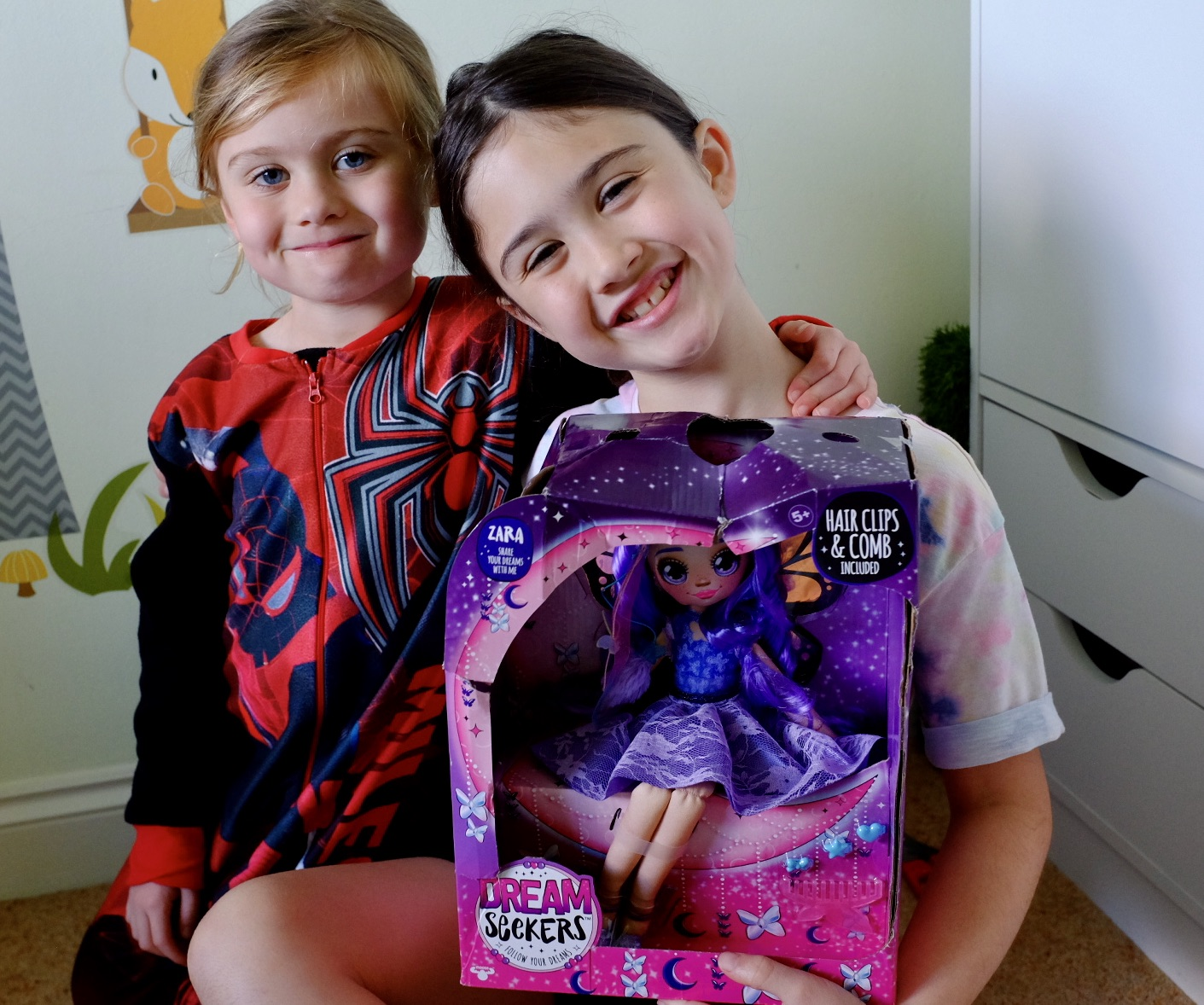 two sisters holding Dream Seeker Zara in the box