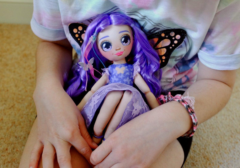 Dream Seeker Doll Zara on girl's lap